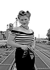 Assassin fashion (Vorona Photography) Tags: city red urban irish usa wall shirt danger america train grit graffiti photo washington cool model chelsea state image head south united traintracks tracks picture rail railway olympus gritty redhead neighborhood photograph weapon pistol spy agent local tacoma states vignette pinup espionage striped controversial kyger