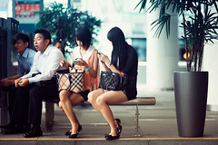 Bored On A Bench (Jon Siegel) Tags: girls bus men boys bench nikon women singapore waiting sitting f14 85mm nikkor mobilephones singaporean d700 nikkor85mmf14afd