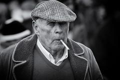 Casting a cold eye (Frank Fullard) Tags: street ireland portrait bw horse irish cold eye galway mono candid fair smoking cap smoker maam maamcross fullard frankfullard