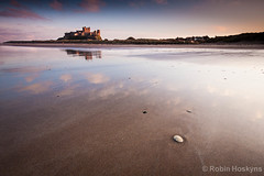 Bamburgh Reflection ([[BIOSPHERE]]) Tags: sunset sea seascape reflection castle beach landscape northumberland bamburgh