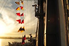 Flags At Sunset (Chris Hunkeler) Tags: sunset flags naval backlighting ussmidway iru9598