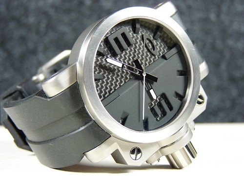 who makes oakley watches k9rm  Oakley Gearbox Titanium Brushed w/Black Carbon Dial
