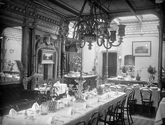 Dining Saloon on the S.S. Great Eastern (National Library of Ireland on The Commons) Tags: ireland dublin plants painting palms print bread pepper glasses ship salt mirrors meat chandelier diningroom jug curtains plates tablecloth steamship pillars moulding 1886 leviathan cutlery pampasgrass couches decanter brunel glassnegative isambardkingdombrunel northwall leinster 1887 greateastern cablelaying ssgreateastern robertfrench williamlawrence nationallibraryofireland isambardbrunel scottrussell epergne cablelayingship lawrencecollection locationidentified easterncompany jscottrussellco greatshipcompany easternsteamnavigationcompany