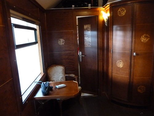 AL Andalus - luxury train in Spain - Superior Suite, armchair, table, door to bathroom, cupboard