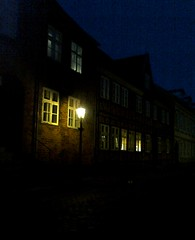 Sct. Mogensgade. Street in Viborg after dark (Jaedde & Sis) Tags: mogensgade viborg street night lamp pregamewinner windows gamewinner herowinner storybookwinner 15challengeswinner challengeyouwinner