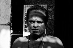 The Light Shower (eternal_ag0ny) Tags: street light shadow portrait india white man black eye face religious photography nikon bangalore nikkor avenue hindu 18200mm d300s