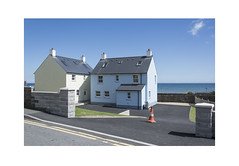 New Houses with Cone (Pictures from the Ghost Garden) Tags: nikon d7100 dslr 18105mm unitedkingdom uk wales pembrokeshire amroth coast coastal seaside buildings architecture windows sky blue clouds urbanlandscape