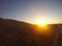 Sun setting over Cape Cod (Grace.Win) Tags: gopro fence grass seagrass sunset sun marconibeach massachusetts capecod