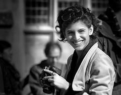 Pretty & The Engaging Smile (Just Ard) Tags: woman pretty photographer smile camera eyecontact people person face street photography candid unposed black white mono monochrome bw blackandwhite noiretblanc biancoenero schwarzundweis zwartwit blancoynegro  justard nikon d750 85mm