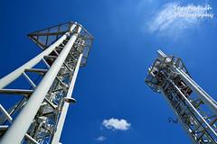 Steel Towers (jonnywalker) Tags: salfordquays manchester salford lowryoutletmall manchestershipcanal quays footbridge millenniumfootbridge bluesky steelmasts steel towers
