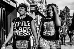 Street - Little black dress (Franois Escriva) Tags: street streetphotography candid people sky blue light sun black white bw noir blanc nb women little dress tshirt smile smiling olympus omd laugh laughing mont