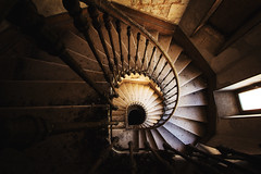 Between the kingdom of the living and the dead (Alexandre Katuszynski) Tags: urbex interiors urbanexploration ue urbexfrance staircase stairs spiral escalier abandonedstaircase decay derelict decayed dust dark creepy eerie castle abandonedcastle chateauabandonné chateau verlassen forgotten lostplaces lowlight light