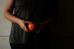 Girl and Kaki (Tinina67) Tags: woman france girl fruit hand arm tina persimmon frau frucht kaki obst tinina67 aumarron