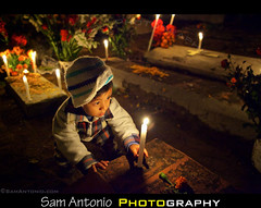 Day of the Dead in Xoxocotlan Cemetery, Oaxaca, Mexico (Sam Antonio Photography) Tags: autumn light boy portrait people tree halloween latinamerica cemetery graveyard square dayofthedead mexico outdoors fire photography death dawn candle child natural ghost religion illuminated full spirits frame oaxaca fullframe gravesite highiso traditionalculture mezcal oaxacacity mescal childrenportrait traveldestinations colorimage childportrait lowlightphotography mexicanculture diadelmuertos fullframesensor dayofthedeadmexico mediumgroupofpeople michoacanstate dayofthedeadoaxaca eldiadelmuertos dayofthedead2012