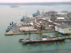 Warships in the Naval Dockyard - fake tilt shift (davekpcv) Tags: uk england ships navy fake hampshire portsmouth spinnakertower warship dockyard tiltshift toytown hmswarrior thesolent gosportoct2010