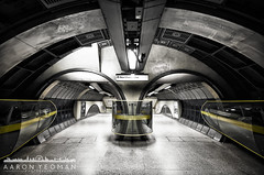 Looking Down the Barrel (Aaron Yeoman) Tags: city uk greatbritain travel england urban blackandwhite bw london lines station yellow architecture modern londonbridge underground subway blackwhite europe arch metro unitedkingdom empty curves transport tube perspective railway tunnel arches symmetry line walkway transportation gb symmetrical tubestation walkways londonunderground subwaystation curve tunnels vignetting vignette thetube metrostation northernline a77 tfl selectivecolour lul theunderground undergroundstation rapidtransit londonbridgeundergroundstation metropolitanrailway colourpopping londonbridgetubestation railtransport sigma1020mm1456exdchsm sonya77 silverefexpro2 slta77 sonyalphaslta77