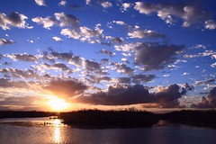 Powderpuff (PelicanPete) Tags: sunset reflection nature river unitedstates florida wildlife national everglades cloudscape refuge southflorida loxahatchee palmbeachcountyflorida