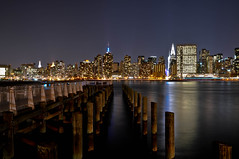 Gantry Plaza State Park - NY (ElianePires) Tags: nyc newyorkcity longexposure ny newyork reflection night buildings river lights pier manhattan queens empirestate luzes chryslerbuilding reflexo longislandcity waterscape manhattanview iloveny d90 gantryplaza gantryplazastatepark tamron1750