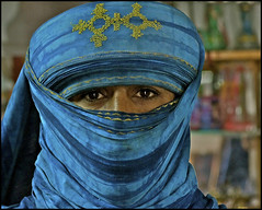 the eyes of tunisia .... (ana_lee_smith) Tags: africa travel blue portrait people southwest tourism square lens photography town eyes sand desert minolta bokeh tunisia north photojournalism motorcycles dromedary camel oasis beercan arab transportation mopeds pedestrians af arabian tribe kohl wrangler douz reforms nomadic 70210mm chech gatewaytothesahara analeesmith arabspring sonyslta33 mrazig