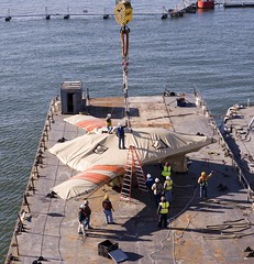 The X-47B Unmanned Combat Air System demonstrator is loaded onto USS Harry S. Truman. (Official U.S. Navy Imagery) Tags: heritage america liberty freedom commerce unitedstates military norfolk navy sailors fast worldwide va tradition usnavy protect deployed flexible onwatch beready defendfreedom warfighters nmcs chinfo sealanes warfighting preservepeace deteraggression operateforward warfightingfirst navymediacontentservice