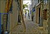 streets of tunisia ..... (ana_lee_smith) Tags: africa street travel blue tourism lens photography mediterranean doors tunisia north photojournalism beercan walkway alleyway paving medina walls ladder hammamet oldtown narrow flagstone fortified analeesmith minoltaaf70210mm sonyslta33