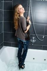 Mel's wetlook debut (Wet and Messy Photography) Tags: woman wet water girl shower wasser mel jeans heels wethair wetlook wetjeans