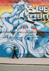 Blue Mountain (joshuacolephoto) Tags: bristol stokes croft blue mountain city street streetphotography colour fuji pro 400h film 135 35mm nikon fe2 travel tiny man graffiti graff mural wall building