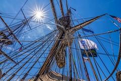 Look Up (Wes Iversen) Tags: sun michigan sails flags americanflags ropes masts tallships rigging baycity sunstars sunflares tokina1116mmf28 tallshipcelebration