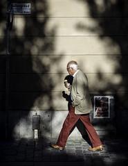 Little red riding pants (Markus Jansson) Tags: street shadow shadowplay wall walking red icecream walkby asahi takumar smc 55mm manualfocus manual legacy