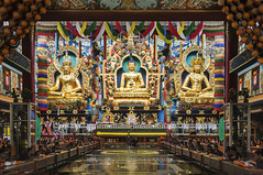 Bylakuppe Buddha Padmasambhava and Amityus (Anoop Negi) Tags: bylakuppe karnataka india monastery namdroling golden temple padmasambhava vihara amityus amitayus statue bhoomisparsha buddha buddhist iconography color monks sitting photo photography anoop negi ezee123
