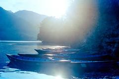 Sunshine Canoe (hiphopmilk) Tags: film analog analogue 135film 35mm yashica yashicaj jaredyeh hiphopmilk nepal pokhara kaski gandaki phewa lake tal fewa sarangkot kaskikot boat ship canoe water sun sunshine mountain lakeside kodak kodakfilm flare