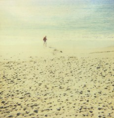 september sand (www.matteovarsi.com) Tags: september fall endingsummer boy solitaryboy beach sand colors sea seashore polaroid 600film expiredfilm
