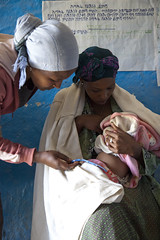 Health Extension Worker checks baby Moges's breathing to determine improvement of pneumonia