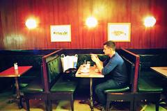 (lussul) Tags: vienna wien man guy film coffee analog vintage austria cafe friend iso400 interior retro september 2012 mentone canoneos300