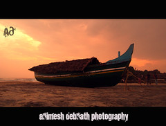 prepared for the voyage (Animesh2000) Tags: ocean road blue light sunset red sea orange cloud india flower macro reflection art beach home nature floral beautiful leaves night photography mono boat pattern artistic dusk kerala photograph sail kovalam calicut animesh debnath