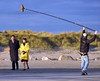 Gabriel Bryne filming scenes with actress Aisling Franciosi on Dollymount Strand for new BBC drama, 'Quirke'