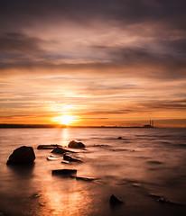 Sunset at Longniddry beach (Chris Shanks) Tags: chris light sunset sun seascape reflection beach water walking landscape scotland rocks glare shanks penicuik longniddry stunningskies 10stopper