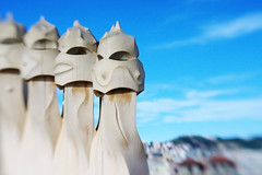 Strange Chimneys (JebbiePix) Tags: barcelona blue chimney sky lensbaby spain pentax gaudi chimneys casamila