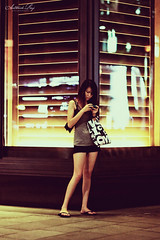 Every woman is a rebel, and usually in wild revolt against herself. (Sathish Raj) Tags: life woman mobile night canon eos singapore flickr alone sundown orchard busy 7d lone sg occupied ion messaging preoccupied flickraward blinkagain