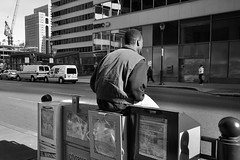 taking a load off (damonabnormal) Tags: street city urban blackandwhite bw man philadelphia nikon december sitting metro box candid snapshot newspapers streetphotography chilling philly nikkor seated phl loitering 2012 chillax urbanite loafer d90 citypaper phillystreetphotography