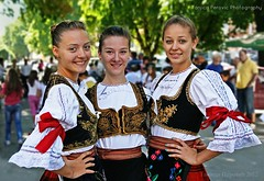 Serbian Girls in National Dress. Tanjica Perovic Photography. (Tanjica Perovic) Tags: groupportrait serbiannationalcostume girlswearingtraditionalserbianclothes church orthodox feast beautiful young serbia srbija pirot sigma1770mm canoneos400d girlsmiling slavagradapirota uspenijepresvetebogorodice sprskanarodnanosnja serbianfolkdress traditional folk clothes cross folklore culture easterneuropean balkans ascentionofmotherofgod youth beauty smile garments traditionalclothes procession celebration tradition sigma1770mmf2845dcmacro pirotski pirotsrbija tanjicaperovic national colours red shirts ribbons српсканароднаношња девојке waistcoats broadsmiles posing lace pirotserbia девојкеусрпскојношњи fotografijepirota tanjicaperovicphotography throughherlens