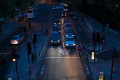 Cars n' Bikes (basselal) Tags: street uk sunset england london cars trafficlight traffic bicycles stop highangle sigma30mmf14exdchsm