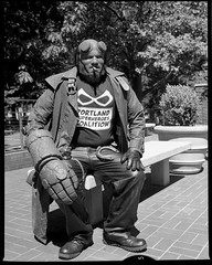 Hellboy at the Museum 160826 (jimhairphoto) Tags: hellboy oregon historic society ohs streetlife streetstories thtrederue portland america pdx portlandnw remainsoftheday naturalworld 4x5project crown graphic camera mfg1963 purchasedat bluemooncamera andmachine 4x5 ilford hp5 film blackandwhite blancetnoir schwarzeaufweis blancoynegro blancinegre siyahrebeyaz jimhairphoto