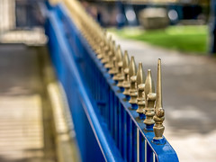 A railing (Mayur Shivz - Out and about casual photography) Tags: railing spades spade fence shallow depth field bokeh olympus m zuiko f18 45mm pattern angle gold blue micro four third photography shiv mayur omd em5 object metal