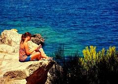 A Little Place Of Peace (MICHAEL*NIEßEN) Tags: blue blau wasser felsen rock peace woman mallorca spain santaponca rx100 sony holiday urlaub reading lesen ocean