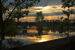 Sunset, Columbus, Ohio (mclcbooks) Tags: sunset dusk evening sky clouds sciotoriver columbusohio reflections bridge trees silhouettes marble laborworkersmemorial