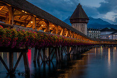 Kapellbrcke (btdonnelly83) Tags: wood beautifularchitecture traveller sunset old trussbridge evening longexposure amazingplaces suisse travel amazingtravelshots truss europe travels flowers amazing switzerland tourist icon travelling amazingtravel tourism iconic river bridge riverreuss architecture woodenbridge reuss lucerne swiss luzern