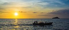 Pescadores en la Gaira (JOMAGACOL) Tags: caribe colombia santamarta atardecer trabajo mar sol brisa pentax jomaga sunset blue sea natural sun orange