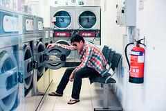 Pause (Jon Siegel) Tags: nikon nikkor 50mm 12 nikon50mmf12ais 50mmf12 man boy fashion fashionable people laundromat laundry coinwash night evening singapore singaporean sunglasses cinematography cinematic