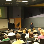 A professor presenting to other faculty members during Faculty Forum
